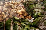 A traditional mumu of pigs and food for the launch ceremony.